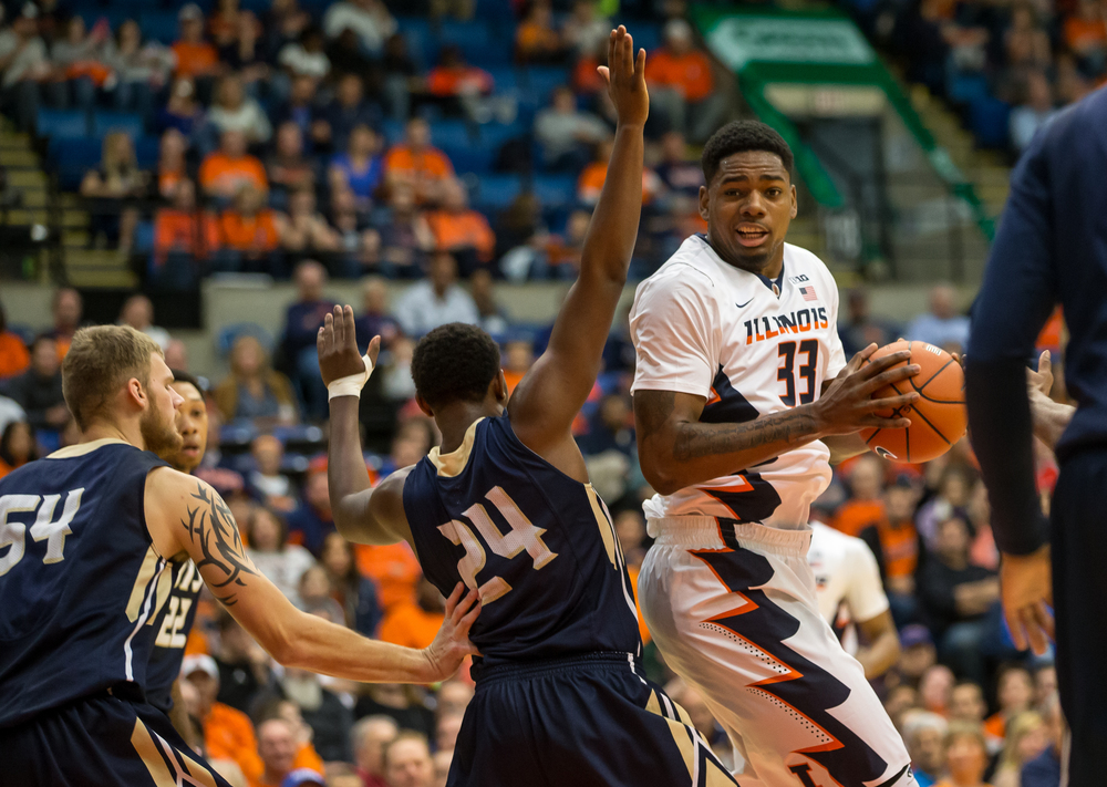 University of Illinois' Mike Thorne Jr. (33) tries to spin around the defense of University of Illinois Springfield's Jamall Millison (24) as he drives towards the basket in the first half during an exhibition game at the Prairie Capital Convention Center, Sunday, Nov. 8, 2015, in Springfield, Ill. Justin L. Fowler/The State Journal-Register