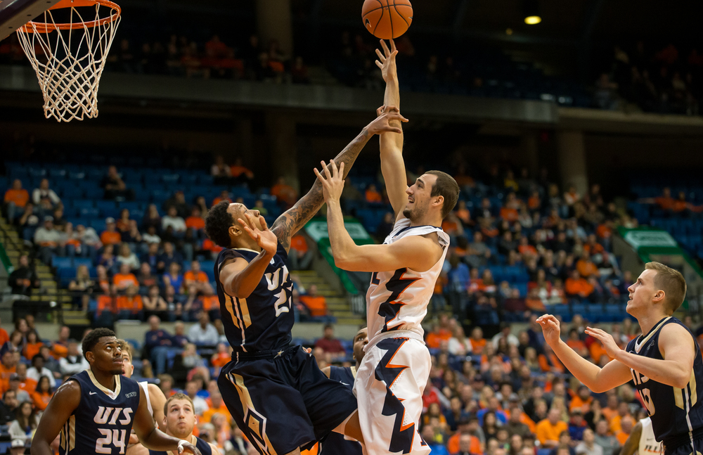 University of Illinois' Maverick Morgan (22) draws the foul from University of Illinois Springfield's Richard Freeman (22) as goes for a shot in the first half during an exhibition game at the Prairie Capital Convention Center, Sunday, Nov. 8, 2015, in Springfield, Ill. Justin L. Fowler/The State Journal-Register
