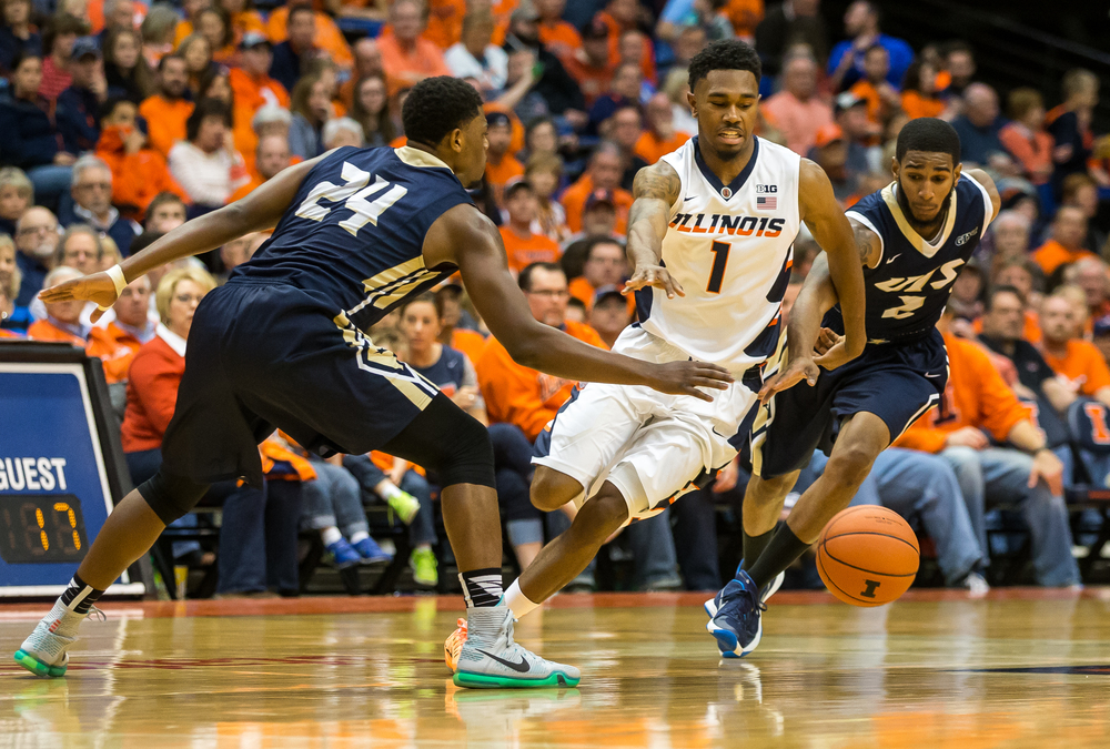 University of Illinois' Jaylon Tate (1) splits the defense of University of Illinois Springfield's Jamall Millison (24) and Davi Austin (2) as he runs across half court in the first half during an exhibition game at the Prairie Capital Convention Center, Sunday, Nov. 8, 2015, in Springfield, Ill. Justin L. Fowler/The State Journal-Register