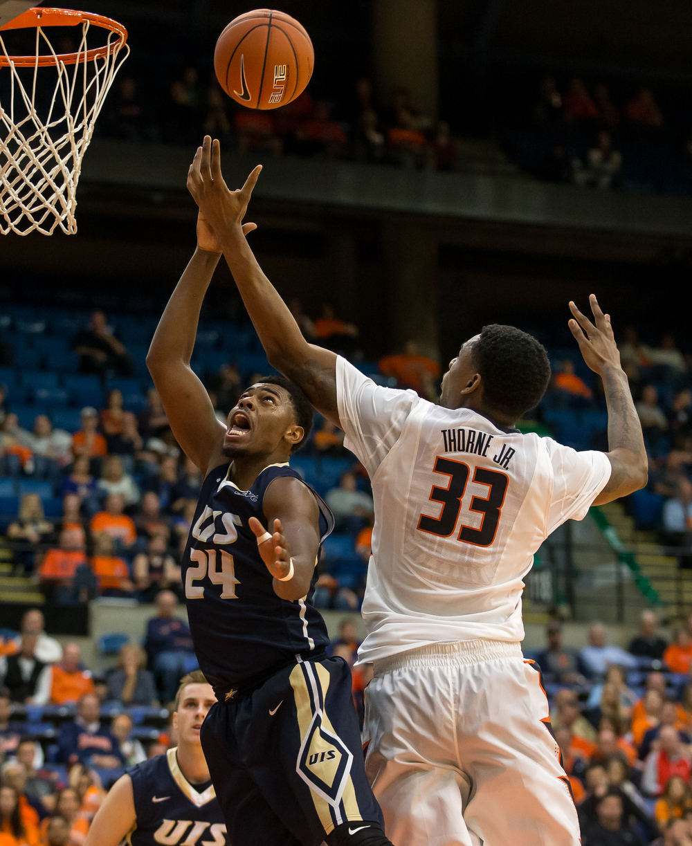 University of Illinois' Mike Thorne (33) fouls University of Illinois Springfield's Jamall Millison (24) going for a rebound in the first half during an exhibition game at the Prairie Capital Convention Center, Sunday, Nov. 8, 2015, in Springfield, Ill. Justin L. Fowler/The State Journal-Register