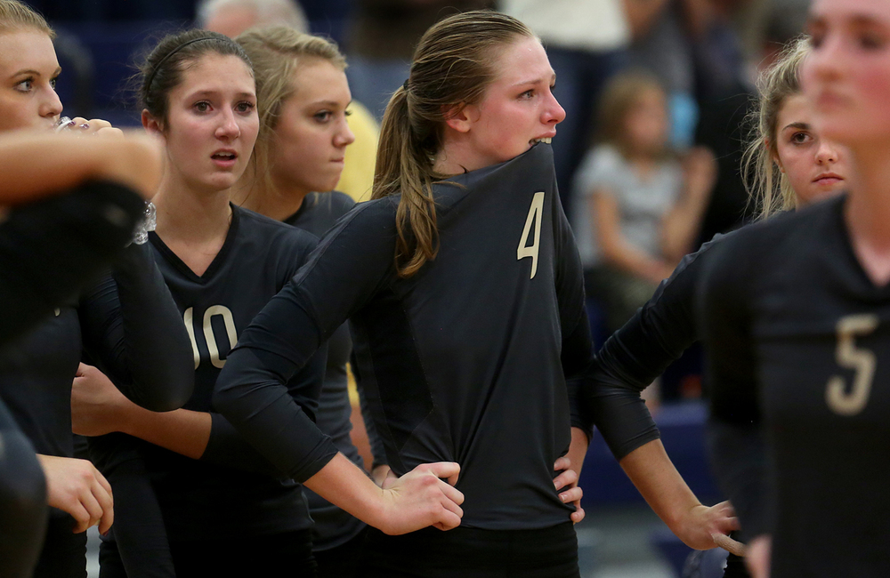 Sacred Heart Griffin players including #4 Delaney Jordan at center react to losing in the very close third game Thursday night. Quincy Notre Dame defeated Sacred Heart-Griffin two games to one to win the Class 3A Rochester Sectional volleyball championship held at Rochester High School on Thursday, Nov. 5, 2015. David Spencer/The State Journal-Register
