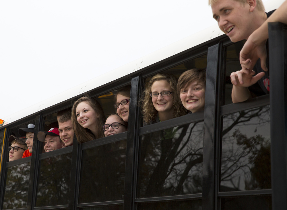 Morrisonville High students headed to Washington, D.C. posed for parents before the bus pulled out of the parking lot Tuesday, Nov. 3, 2015. Rich Saal/The State Journal-Register