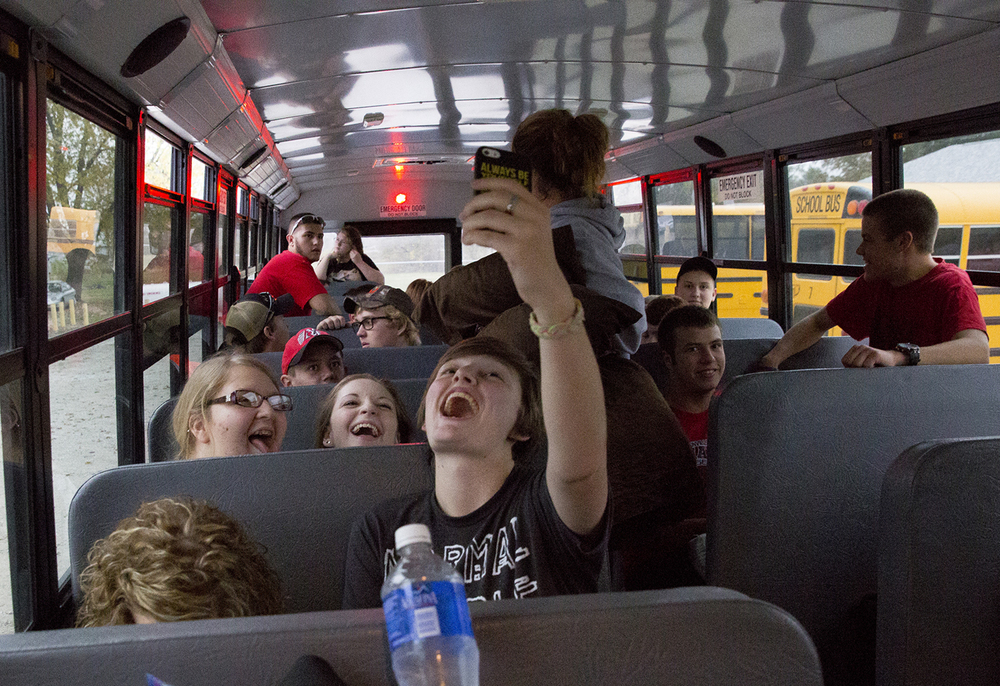 Lexi Taylor snaps a photo of herself with Justyce Scott, left, and Emilee Mitchell in the seat behind her before they leave from Morrisonville High School on a trip to Washington, D.C. Tuesday, Nov. 3, 2015. Rich Saal/The State Journal-Register