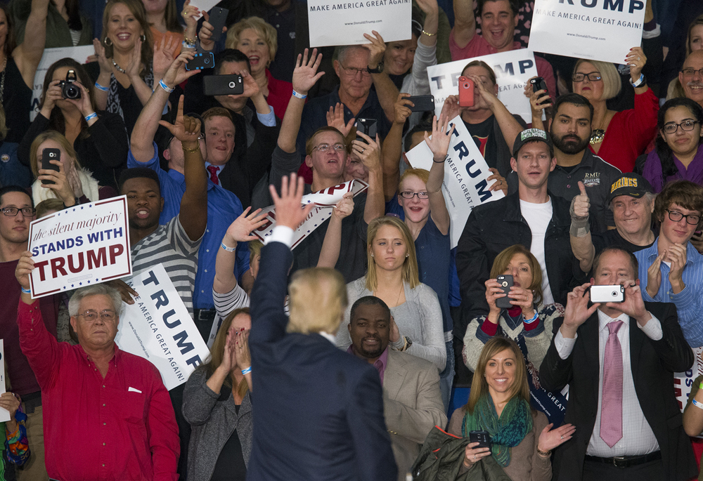 Donald Trump acknowledges supporters who were seated behind him on the stage during a campaign event Monday, Nov. 9, 2015 at the Prairie Capital Convention Center. Rich Saal/The State Journal-Register