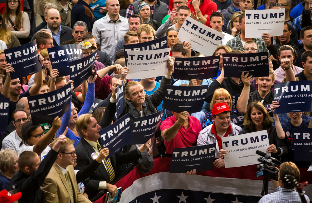 Supporters of Republican presidential candidate Donald Trump show off their signs to the cameras as they wait for Trump to take the stage during a campaign stop at the Prairie Capital Convention Center, Monday, Nov. 9, 2015, in Springfield, Ill. Justin L. Fowler/The State Journal-Register