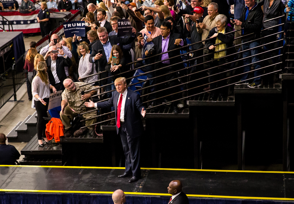 Republican presidential candidate Donald Trump makes he way out on to the stage for his campaign address at the Prairie Capital Convention Center, Monday, Nov. 9, 2015, in Springfield, Ill. Justin L. Fowler/The State Journal-Register