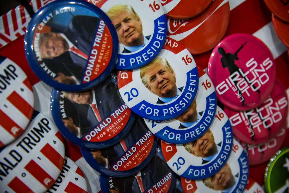 Vendors set up shop outside the Prairie Capital Convention Center selling t-shirts and buttons related to Republican presidential candidate Donald Trump during a campaign stop at the Prairie Capital Convention Center, Monday, Nov. 9, 2015, in Springfield, Ill. Justin L. Fowler/The State Journal-Register
