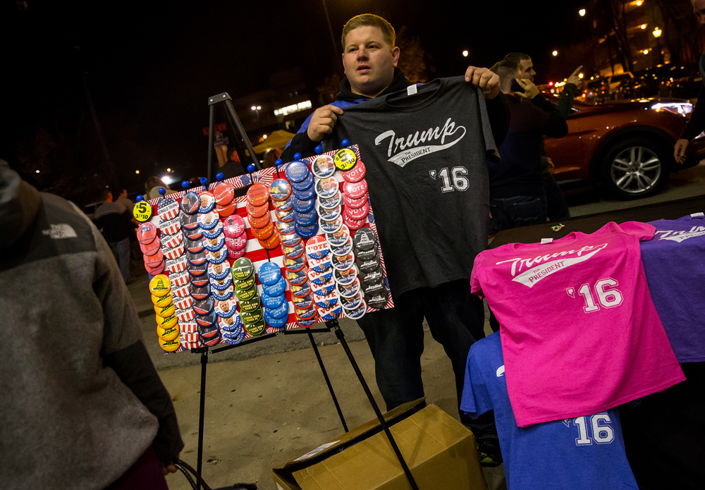 Michael Goodart, of Springfield Mo., set up a shop outside the Prairie Capital Convention Center selling t-shirts and buttons related to Republican presidential candidate Donald Trump during a campaign stop at the Prairie Capital Convention Center, Monday, Nov. 9, 2015, in Springfield, Ill. Justin L. Fowler/The State Journal-Register