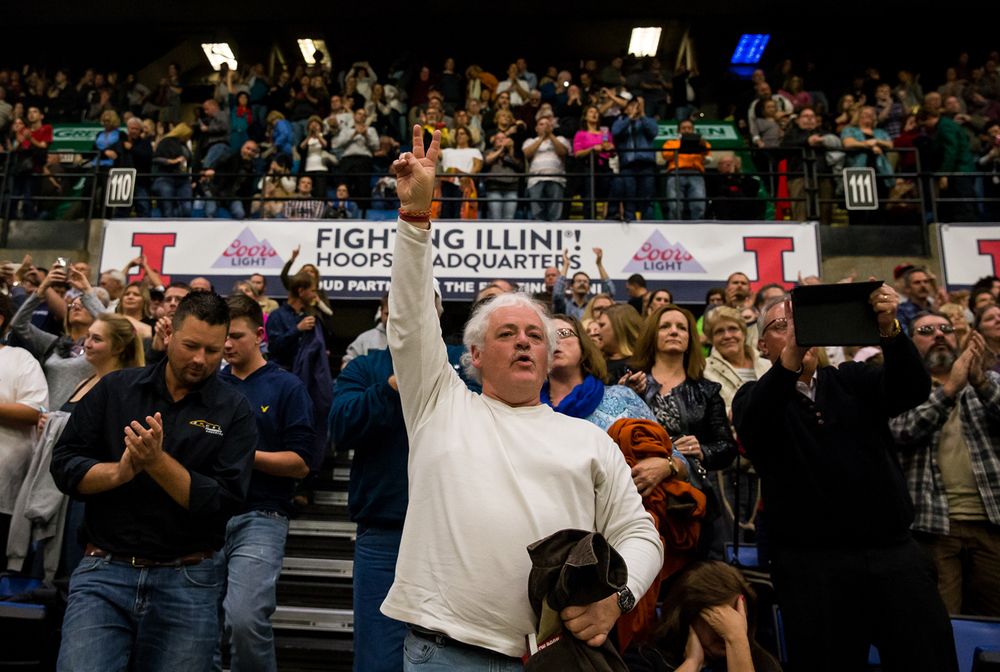 James Ausmus, center, stands up to cheer on Republican presidential candidate Donald Trump at the conclusion of his campaign address during a campaign stop at the Prairie Capital Convention Center, Monday, Nov. 9, 2015, in Springfield, Ill. Justin L. Fowler/The State Journal-Register