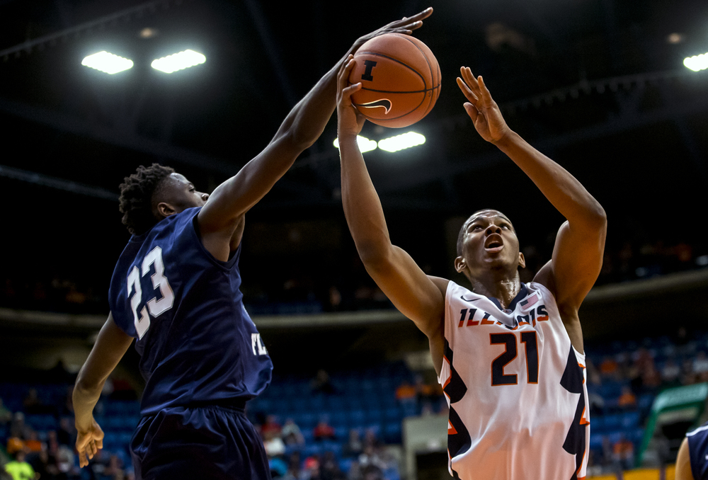 University of North Florida's Nick Malonga (23) blocks a shot from University of Illinois' Malcolm Hill (21) in the first half at the Prairie Capital Convention Center, Friday, Nov. 13, 2015, in Springfield, Ill. Justin L. Fowler/The State Journal-Register