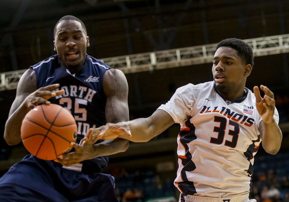 University of North Florida's Chris Davenport (35) wins a rebound against University of Illinois' Mike Thorne Jr. (33) in the first half at the Prairie Capital Convention Center, Friday, Nov. 13, 2015, in Springfield, Ill. Justin L. Fowler/The State Journal-Register