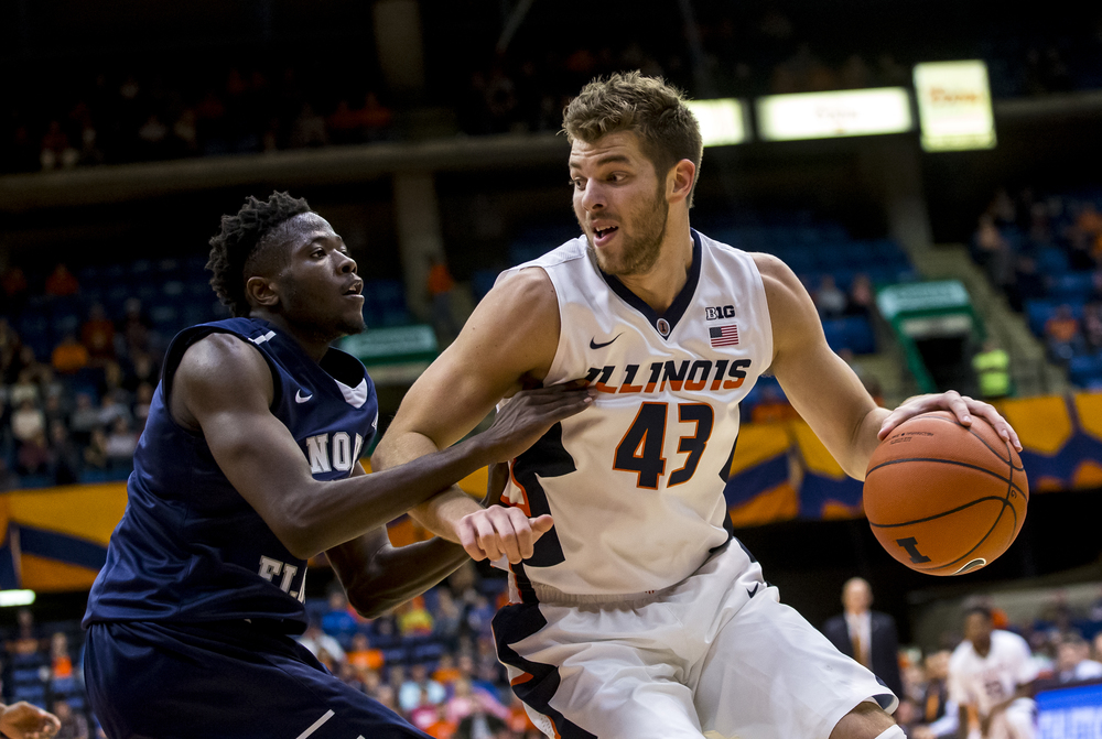 University of Illinois' Michael Finke (43) drives to the basket against University of North Florida's Nick Malonga (23) in the first half at the Prairie Capital Convention Center, Friday, Nov. 13, 2015, in Springfield, Ill. Justin L. Fowler/The State Journal-Register