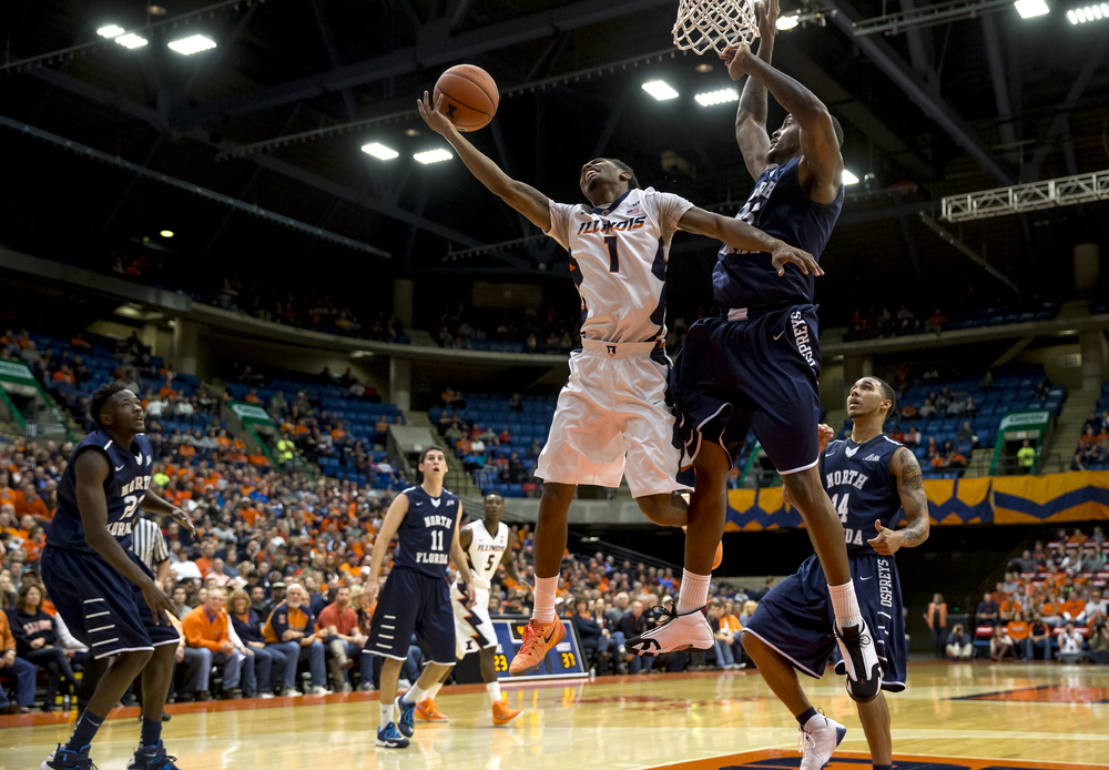 University of Illinois' Jaylon Tate (1) is fouled by University of North Florida's Chris Davenport (35) as he drove up to the basket in the first half at the Prairie Capital Convention Center, Friday, Nov. 13, 2015, in Springfield, Ill. Justin L. Fowler/The State Journal-Register