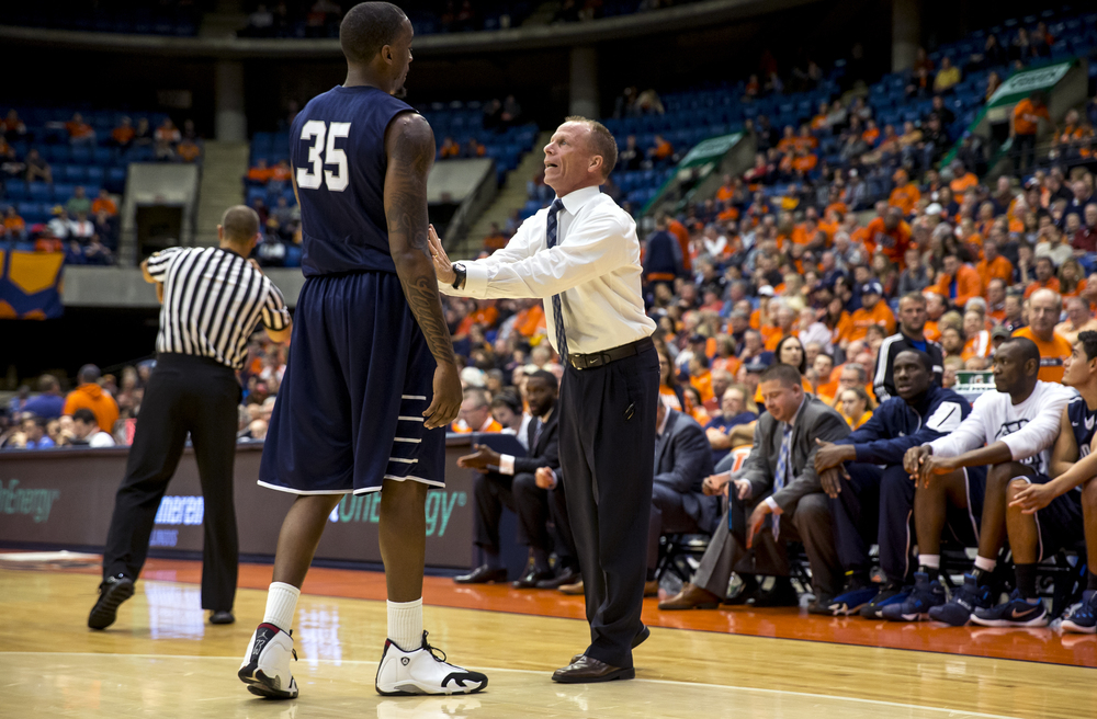 University of North Florida men's basketball coach Matthew Driscoll talks with University of North Florida's Chris Davenport (35) during a break in play against the University of Illinois in the first half at the Prairie Capital Convention Center, Friday, Nov. 13, 2015, in Springfield, Ill. Justin L. Fowler/The State Journal-Register