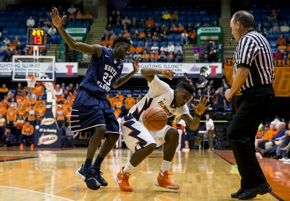 University of Illinois' Aaron Jordan (23) takes a hard foul from University of North Florida's Nick Malonga (23) in the second half at the Prairie Capital Convention Center, Friday, Nov. 13, 2015, in Springfield, Ill. Justin L. Fowler/The State Journal-Register