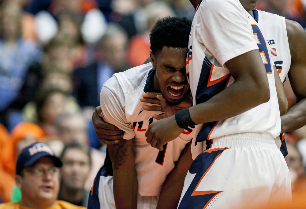 University of Illinois' Jaylon Tate (1) screams out in pain after injuring his hand falling to the court against the University of North Florida in the first half at the Prairie Capital Convention Center, Friday, Nov. 13, 2015, in Springfield, Ill. Justin L. Fowler/The State Journal-Register