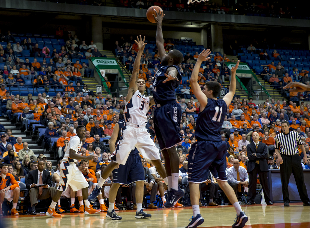 University of North Florida's Demarcus Daniels (32) blocks a shot from University of Illinois' Khalid Lewis (3) in the second half at the Prairie Capital Convention Center, Friday, Nov. 13, 2015, in Springfield, Ill. Justin L. Fowler/The State Journal-Register