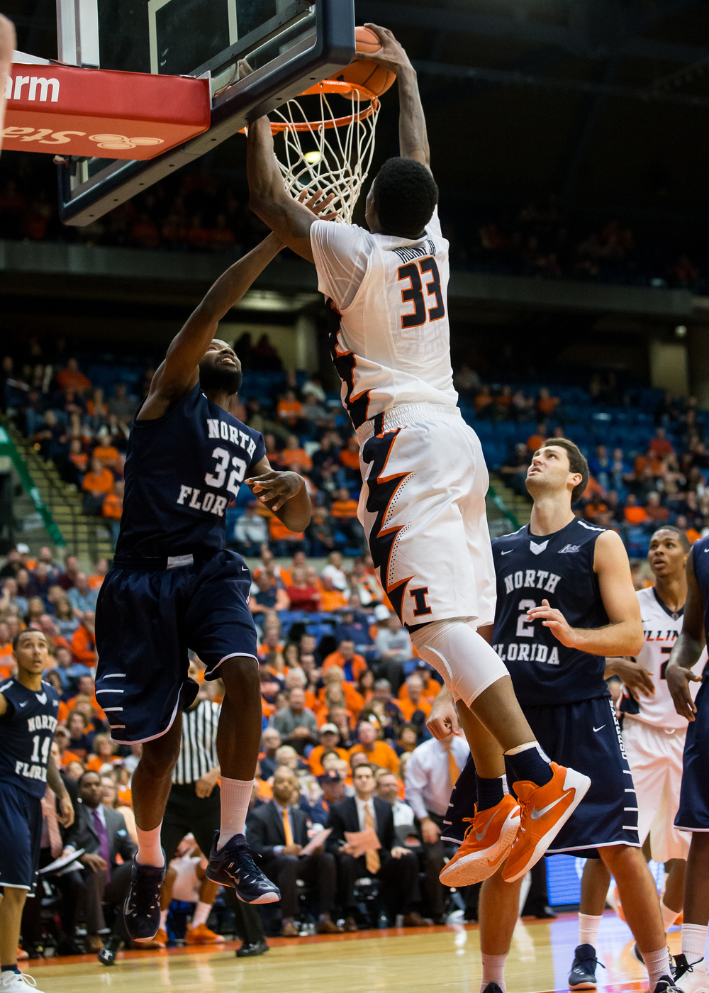 University of Illinois' Mike Thorne Jr. (33) throws down a dunk over University of North Florida's Demarcus Daniels (32) in the second half at the Prairie Capital Convention Center, Friday, Nov. 13, 2015, in Springfield, Ill. Justin L. Fowler/The State Journal-Register