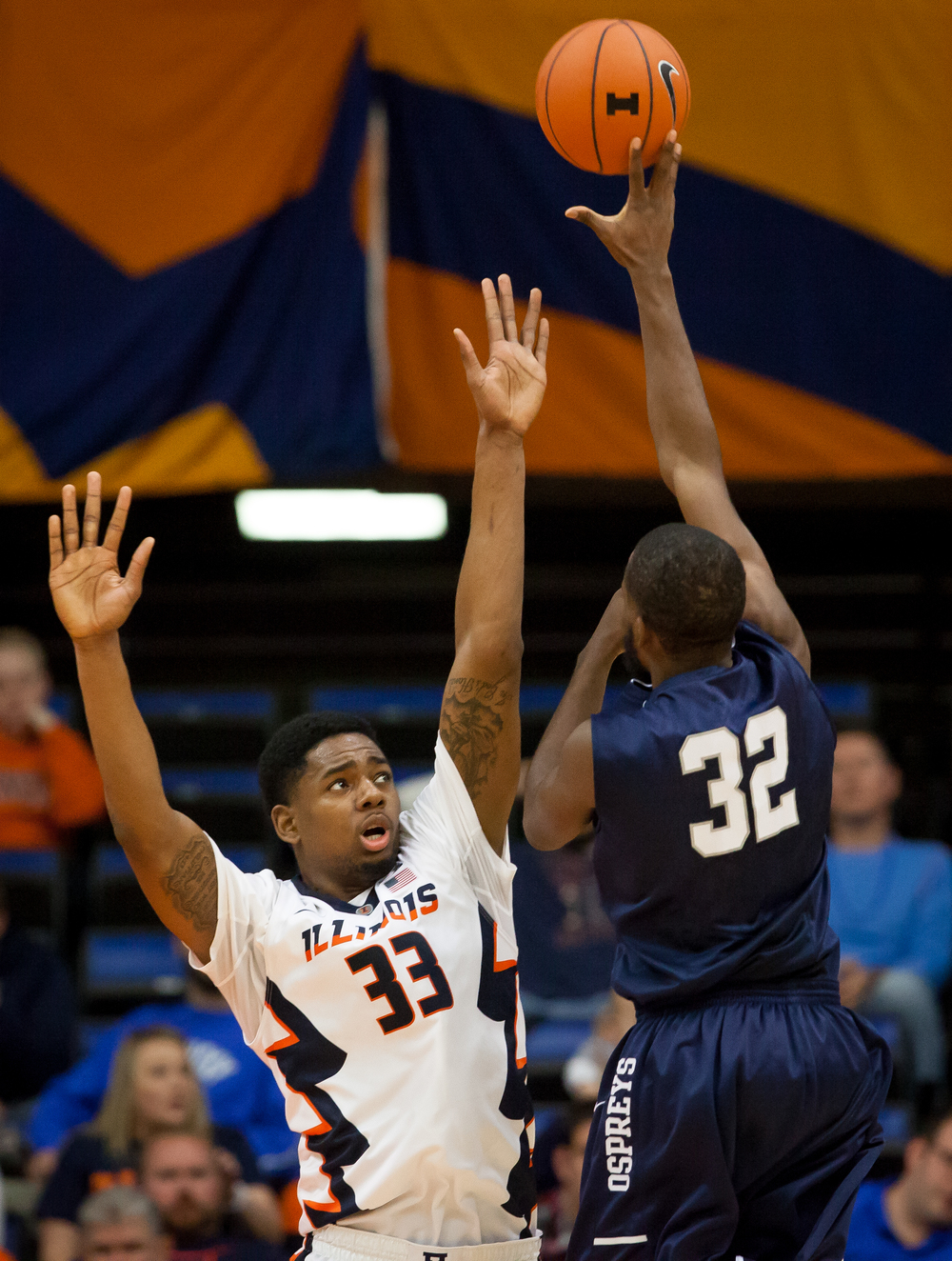 University of North Florida's Demarcus Daniels (32) puts a shot up over University of Illinois' Mike Thorne Jr. (33) in the first half at the Prairie Capital Convention Center, Friday, Nov. 13, 2015, in Springfield, Ill. Justin L. Fowler/The State Journal-Register