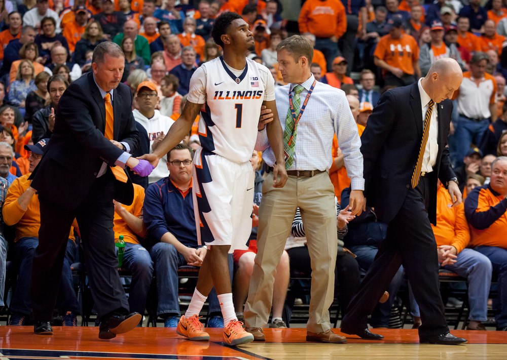 University of Illinois' Jaylon Tate (1) is helped off the floor after injuring his hand against the University of North Florida in the first half at the Prairie Capital Convention Center, Friday, Nov. 13, 2015, in Springfield, Ill. Justin L. Fowler/The State Journal-Register