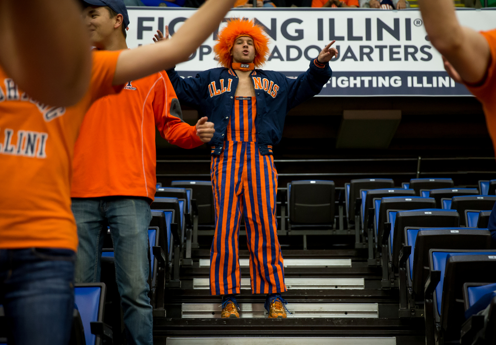 "University of Illinois senior Eric Bulak, center, does jumping jacks as the Orange Krush student section prepares for the game at the Prairie Capital Convention Center, Friday, Nov. 13, 2015, in Springfield, Ill. ""I've been watching them since I was a kid,"" said Bulak. ""It's a dream come true to be in the Orange Krush."" Justin L. Fowler/The State Journal-Register"
