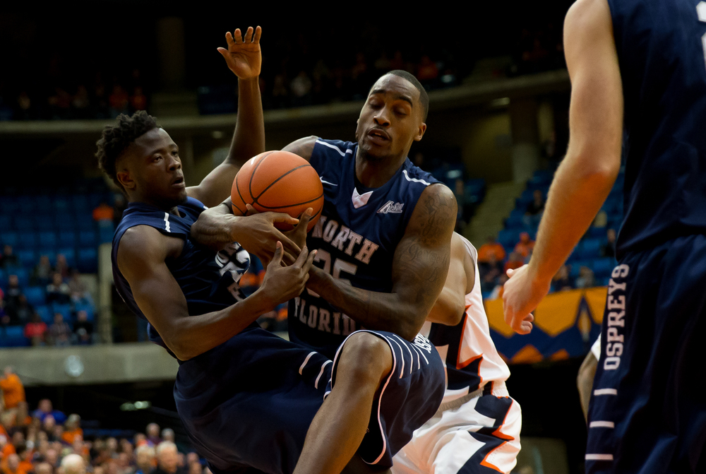 University of North Florida's Chris Davenport (35) wrestles down a rebound against his teammate and from the Illini in the first half at the Prairie Capital Convention Center, Friday, Nov. 13, 2015, in Springfield, Ill. Justin L. Fowler/The State Journal-Register