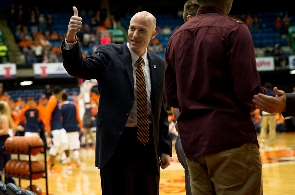 University of Illinois men's basketball coach John Groce sends a thumbs up to the crowd as the Illini take the court agains the University of North Florida at the Prairie Capital Convention Center, Friday, Nov. 13, 2015, in Springfield, Ill. Justin L. Fowler/The State Journal-Register