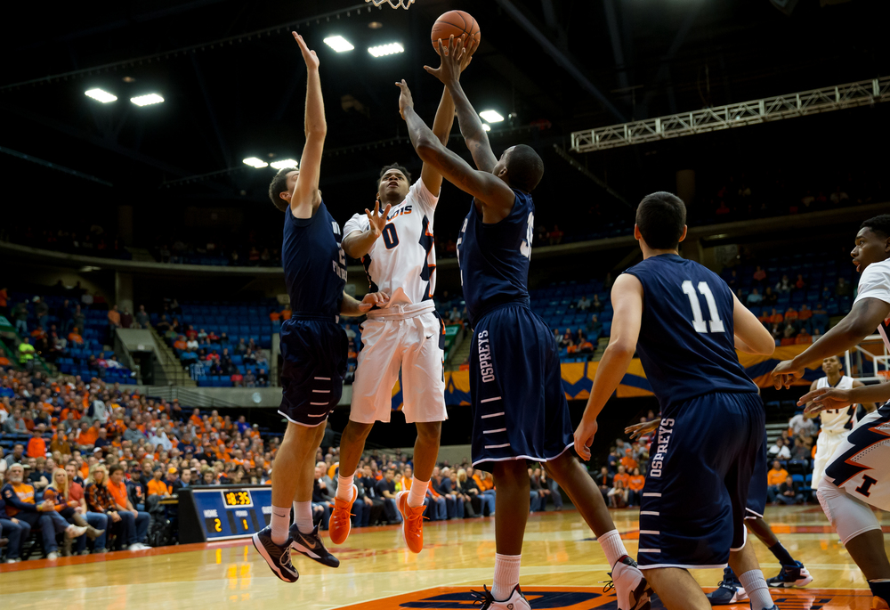 University of Illinois' D.J. Williams (0) splits the defense from the University of North Florida for a basket in the first half at the Prairie Capital Convention Center, Friday, Nov. 13, 2015, in Springfield, Ill. Justin L. Fowler/The State Journal-Register