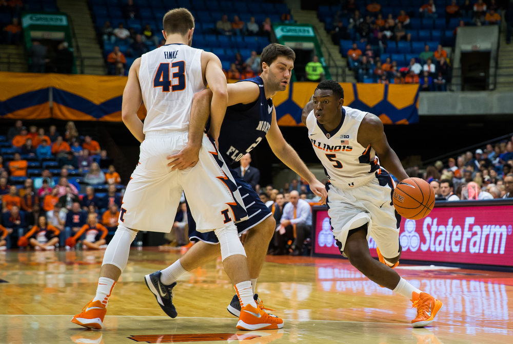 University of Illinois' Jalen Coleman-Lands (5) drives around University of North Florida's Beau Beech (2) with a screen from University of Illinois' Michael Finke (43) as he drives to the basket in the first half at the Prairie Capital Convention Center, Friday, Nov. 13, 2015, in Springfield, Ill. Justin L. Fowler/The State Journal-Register