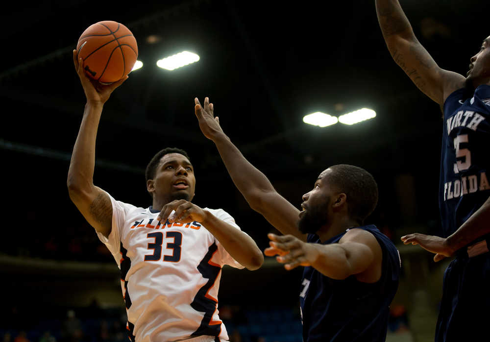University of Illinois' Mike Thorne Jr. (33) attempts a turn around against University of North Florida's Demarcus Daniels (32) in the first half at the Prairie Capital Convention Center, Friday, Nov. 13, 2015, in Springfield, Ill. Justin L. Fowler/The State Journal-Register
