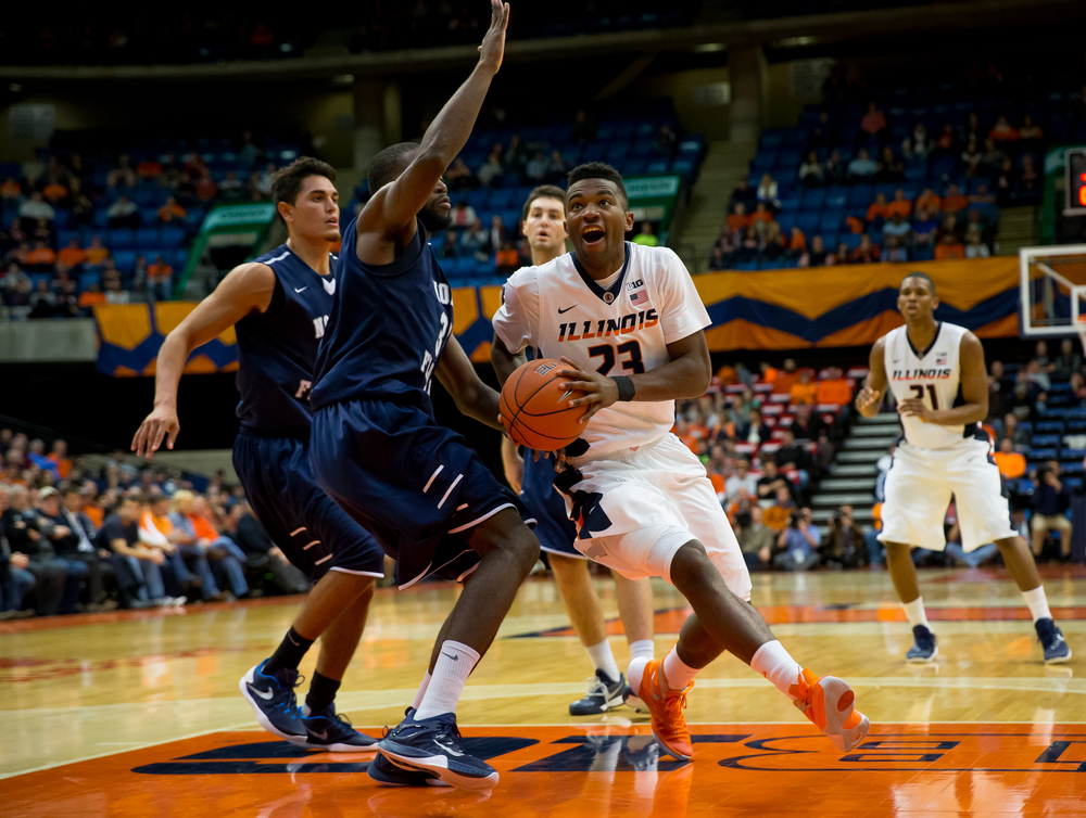 University of Illinois' Aaron Jordan (23) drives around University of North Florida's Demarcus Daniels (32) as he goes up for a basket in the first half at the Prairie Capital Convention Center, Friday, Nov. 13, 2015, in Springfield, Ill. Justin L. Fowler/The State Journal-Register