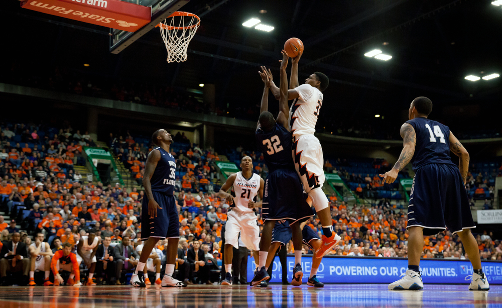 University of Illinois' Mike Thorne Jr. (33) puts up a basket over University of North Florida's Demarcus Daniels (32)  in the second half at the Prairie Capital Convention Center, Friday, Nov. 13, 2015, in Springfield, Ill. Justin L. Fowler/The State Journal-Register