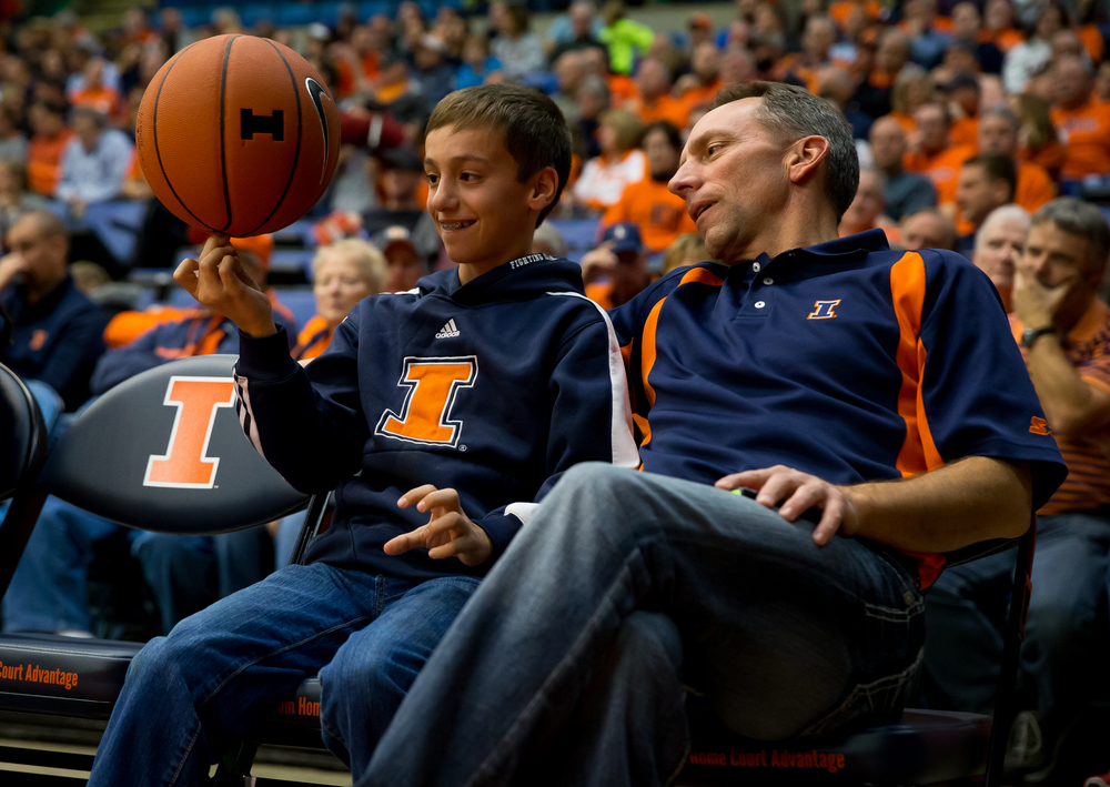 Nick Phalen, 14, spins a basketball on his finger court side during a time out as the University of Illinois takes on the University of North Florida on in the second half at the Prairie Capital Convention Center, Friday, Nov. 13, 2015, in Springfield, Ill. Justin L. Fowler/The State Journal-Register