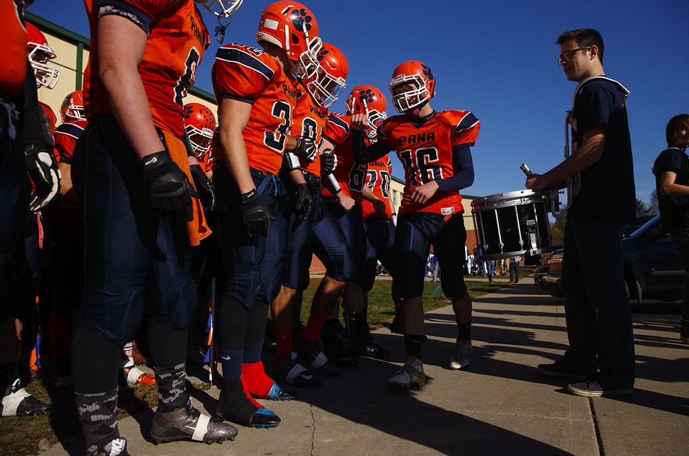 Pana's Rhett Zahradka (16) pumps the team up as they prepare to march to the field to face Auurn during a 2A quarterfinal game in Pana Nov. 14, 2015. Ted Schurter/The State Journal-Register