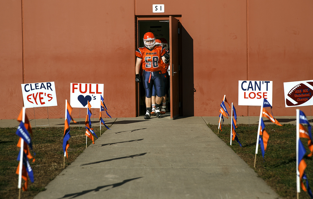 Pana's Connor Voudrie leads the team out of the locker room to face Auburn during the 2A quarterfinal game at Brummett Field in Pana Saturday, Nov. 14, 2015. Ted Schurter/The State Journal-Register