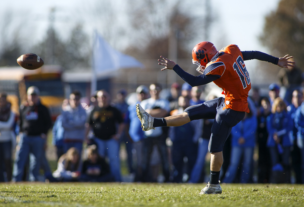 Pana's Rhett Zahradka punts the ball to Auburn during the 2A quarterfinal game at Brummett Field in Pana Saturday, Nov. 14, 2015. Ted Schurter/The State Journal-Register