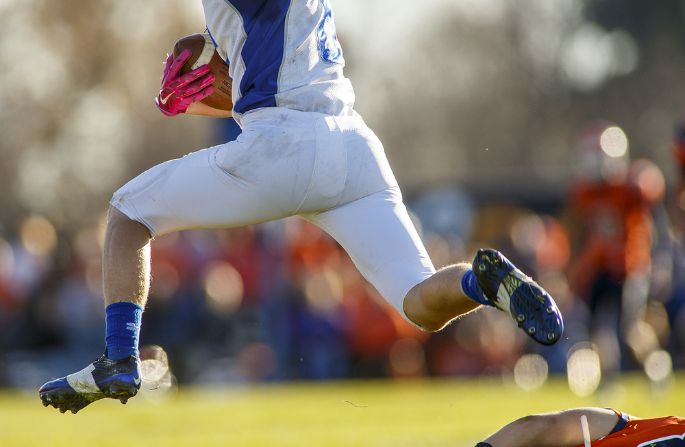 Auburn's Cayden Muench leaps a Pana defender during the 2A quarterfinal game at Brummett Field in Pana Saturday, Nov. 14, 2015. Ted Schurter/The State Journal-Register