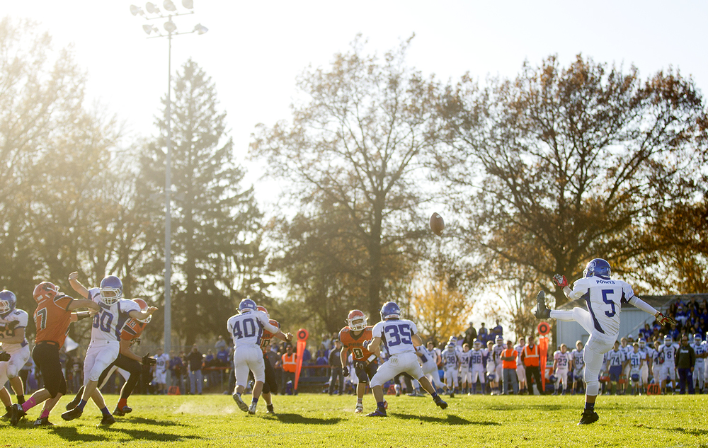 Auburn's Drew Points punts the ball to Pana during the 2A quarterfinal game at Brummett Field in Pana Saturday, Nov. 14, 2015. Ted Schurter/The State Journal-Register
