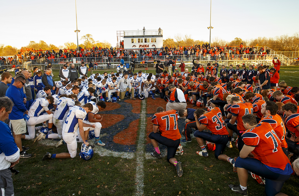 Players, coaches and staff of the Auburn and Pana teams pause for a moment of silence for the victims of terrorism in Paris, France at the conclusion of the 2A quarterfinal game at Brummett Field in Pana Saturday, Nov. 14, 2015. Ted Schurter/The State Journal-Register