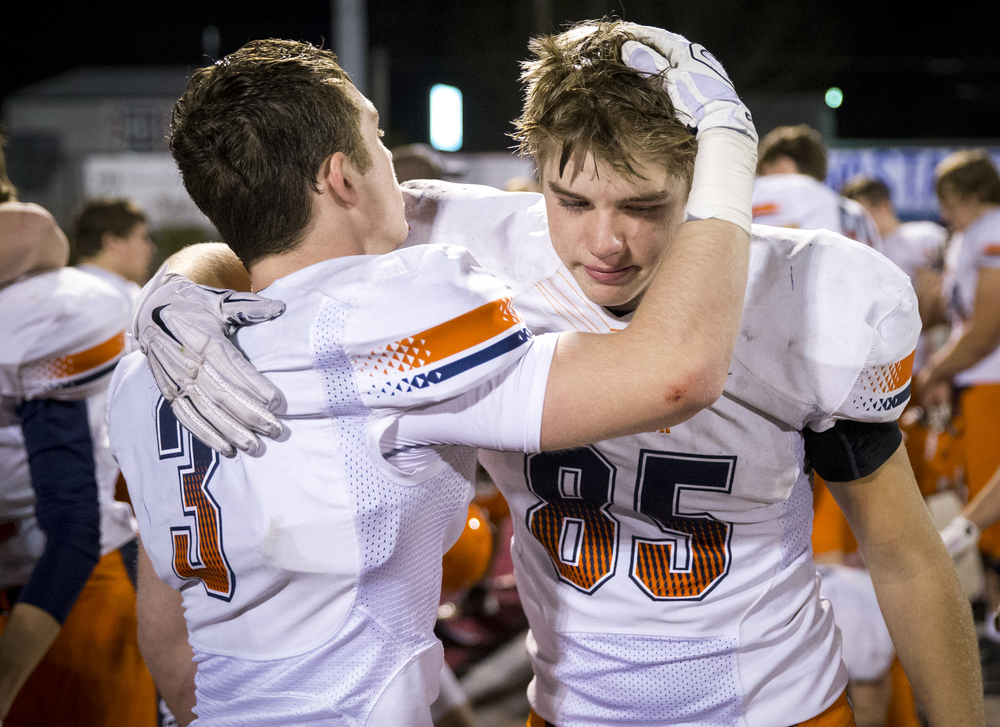 Rochester's Mikey McNicholas (85) gets a hug from Christian Lett (3) after the Rockets were defeated by Belleville Althoff 46-42 at Lindenwood University-Belleville, Saturday, Nov. 14, 2015, in Belleville , Ill. Justin L. Fowler/The State Journal-Register