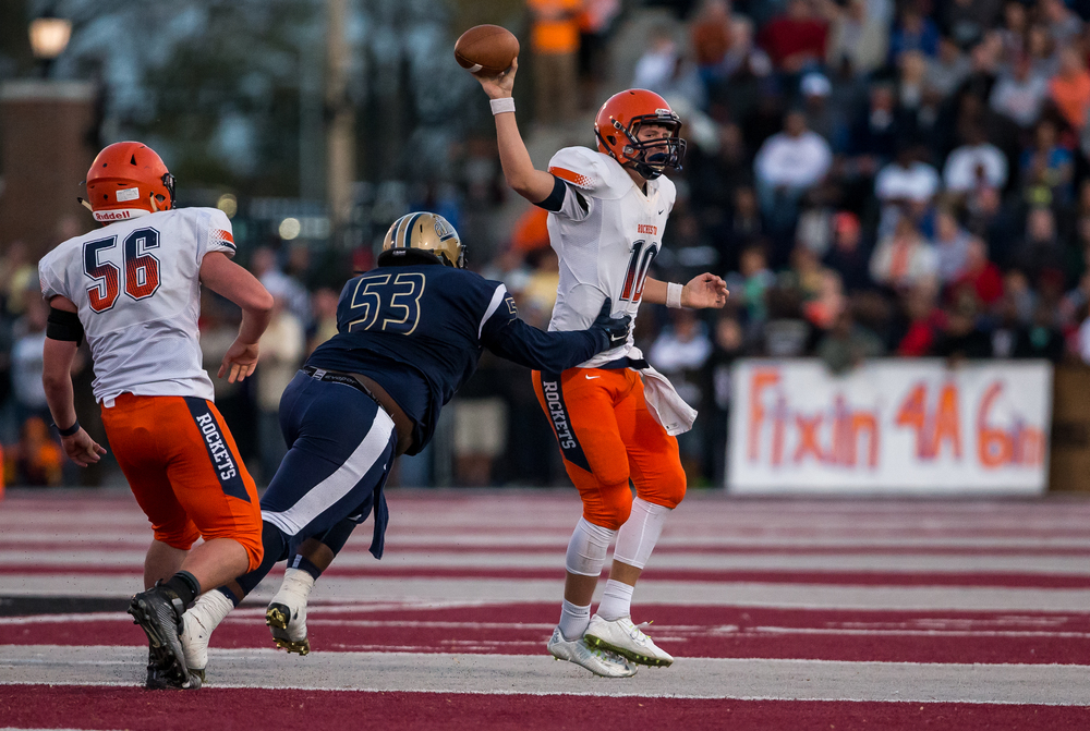 Rochester quarterback Danny Zeigler (10) is called for intentional grounding while under pressure from Belleville Althoff's Devyn Nash (53) in the second half during the quarterfinal round of the Class 4A playoffs at Lindenwood University-Belleville, Saturday, Nov. 14, 2015, in Belleville , Ill. Justin L. Fowler/The State Journal-Register