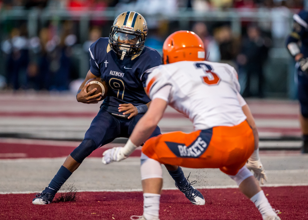 Belleville Althoff's Jaylon Bester (9) cuts back on Rochester's Christian Lett (3) avoiding a tackle on a rush in the second half during the quarterfinal round of the Class 4A playoffs at Lindenwood University-Belleville, Saturday, Nov. 14, 2015, in Belleville , Ill. Justin L. Fowler/The State Journal-Register