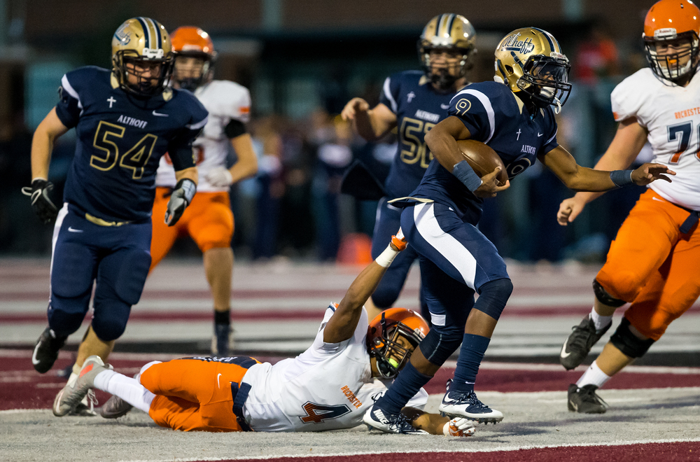 Belleville Althoff's Jaylon Bester (9) spins out of a tackle from Rochester's D'ante' Cox (4) on a rush in the second half during the quarterfinal round of the Class 4A playoffs at Lindenwood University-Belleville, Saturday, Nov. 14, 2015, in Belleville , Ill. Justin L. Fowler/The State Journal-Register
