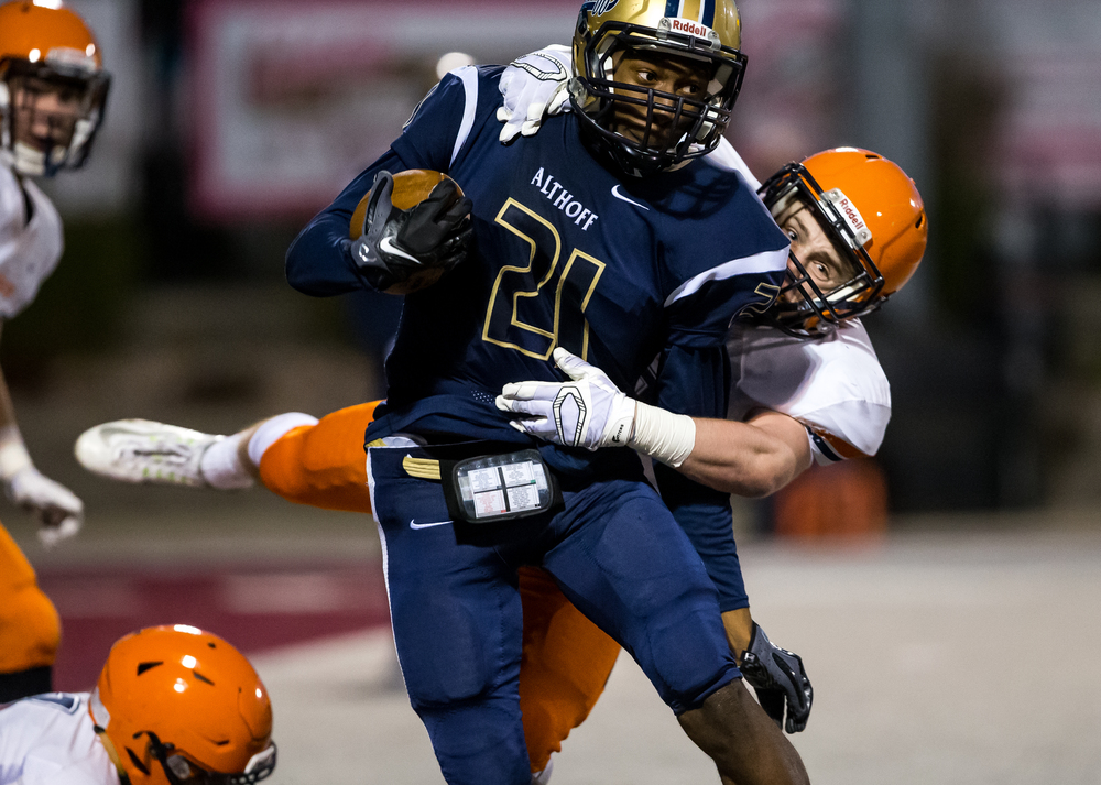 Belleville Althoff's CJ Coldon (21) avoids a tackle from Rochester's Christian Lett (3) while carrying the ball in the second half during the quarterfinal round of the Class 4A playoffs at Lindenwood University-Belleville, Saturday, Nov. 14, 2015, in Belleville , Ill. Justin L. Fowler/The State Journal-Register