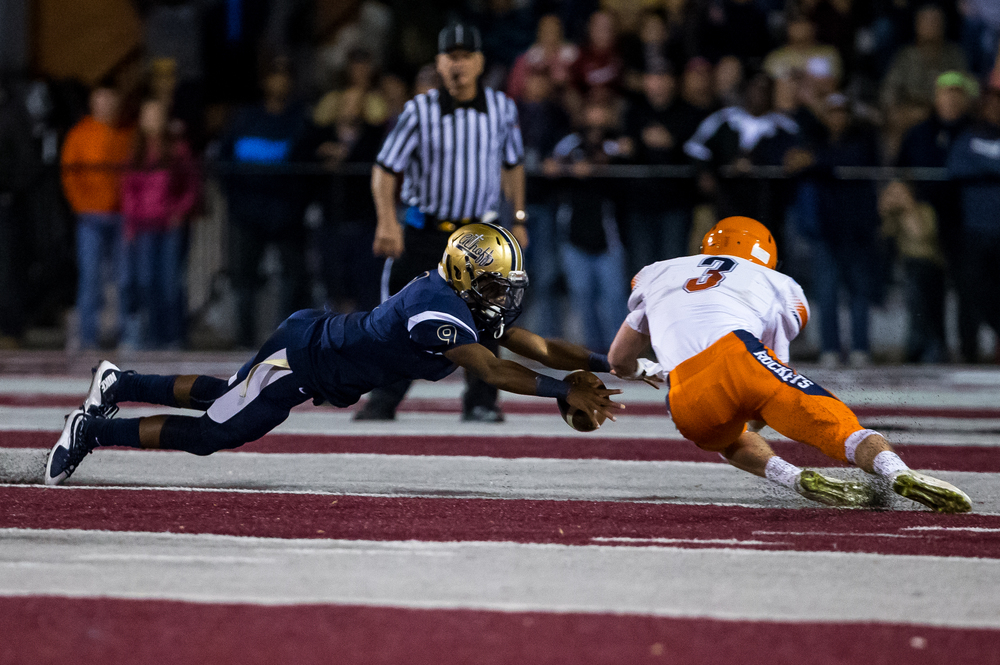Belleville Althoff's Jaylon Bester (9) dives trying to recover a fumble against Rochester's Christian Lett (3) in the second half during the quarterfinal round of the Class 4A playoffs at Lindenwood University-Belleville, Saturday, Nov. 14, 2015, in Belleville , Ill. Justin L. Fowler/The State Journal-Register