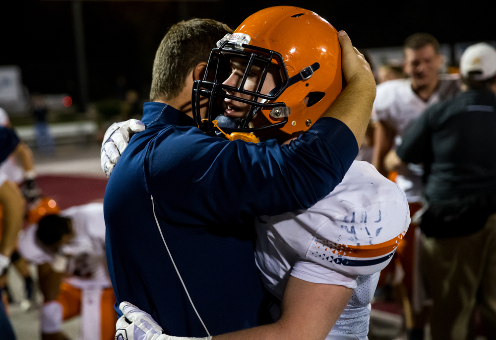 Rochester's Christian Lett (3) gets a hug from head coach Derek Leonard after the Rockets' 46-42 loss to Belleville Althoff in the quarterfinal round of the Class 4A playoffs at Lindenwood University-Belleville, Saturday, Nov. 14, 2015, in Belleville , Ill. Justin L. Fowler/The State Journal-Register