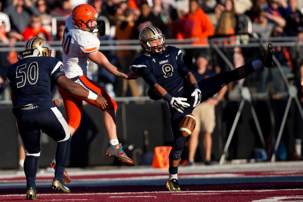 Belleville Althoff's Trevon Mosely (8) nearly intercepts a pass in front of Rochester's Brandon Jones (50) in the first half during the quarterfinal round of the Class 4A playoffs at Lindenwood University-Belleville, Saturday, Nov. 14, 2015, in Belleville , Ill. Justin L. Fowler/The State Journal-Register