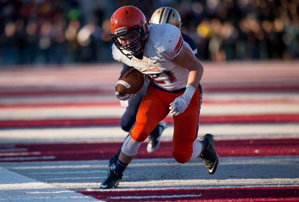 Rochester's Kenny Hedges (21) manages to stay in bounds to gain more yardage on a rush against Belleville Althoff's Melvin Brock (12) in the first half during the quarterfinal round of the Class 4A playoffs at Lindenwood University-Belleville, Saturday, Nov. 14, 2015, in Belleville , Ill. Justin L. Fowler/The State Journal-Register