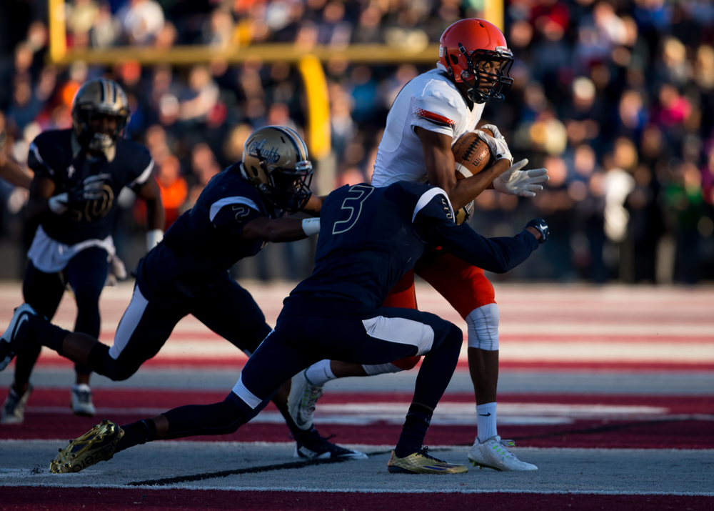 Rochester's Collin Stallworth (8) is brought down by Belleville Althoff's Edwyn Brown (3) after a catch in the first half during the quarterfinal round of the Class 4A playoffs at Lindenwood University-Belleville, Saturday, Nov. 14, 2015, in Belleville , Ill. Justin L. Fowler/The State Journal-Register