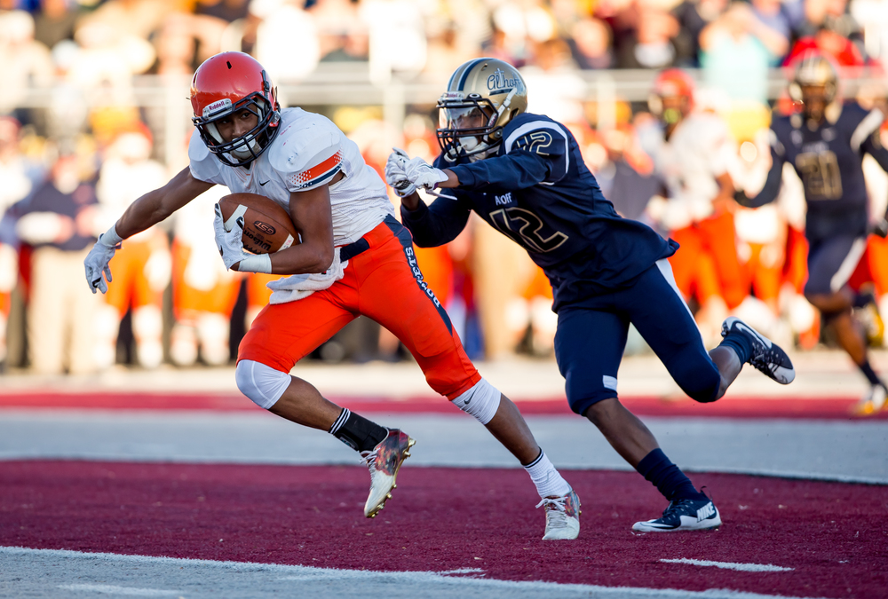 Rochester's Avante' Cox (5) accelerates past Belleville Althoff's Melvin Brock (12) avoiding a tackle on his way to a 45-yard touchdown in the first half during the quarterfinal round of the Class 4A playoffs at Lindenwood University-Belleville, Saturday, Nov. 14, 2015, in Belleville , Ill. Justin L. Fowler/The State Journal-Register